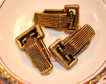Three Vintage faux buckle buttons