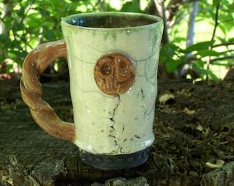 hand made pottery mug altered and high fired raku