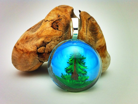 Handpainted Resin Pendant - evergreen tree with grass & sky and a sterling silver bail