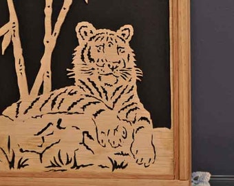 Silhouetted fretwork tiger wall hanging.