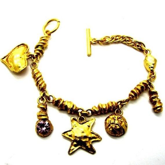 christian lacroix gold tone metal with vintage charms bracelet. Black Bedroom Furniture Sets. Home Design Ideas