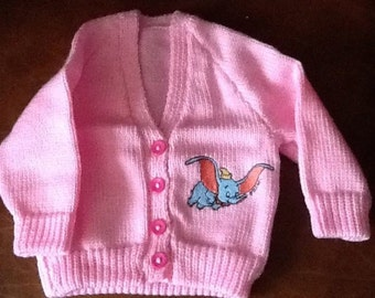 Pink hand knitted baby cardigan with Dumbo embroidery