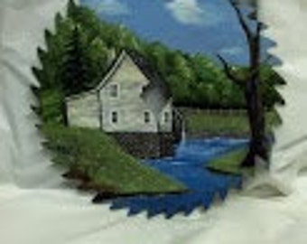"8"" Oil Painted Circular Saw Blade Depicting a Grey Bulding with a Water Wheel and a Stream in the Foreground"