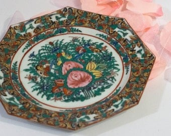 Decorative plate with hand painted flowers and octagon shape