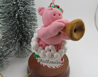 Pink Pig playing the trumpet ornament, 2016 ornament