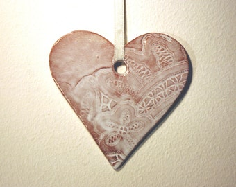 Large white ceramic Valentines day heart ornament with lace pattern.