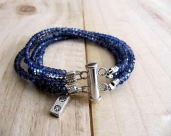 Elegant Iolite bracelet with small Hill tribe silver charm