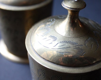Two small, Indian, engraved, brass pots with lids
