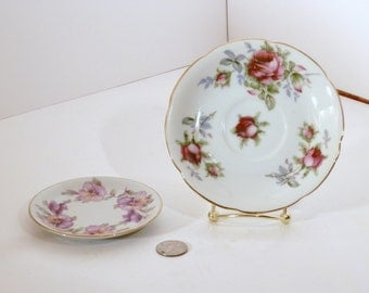 Two vintage saucers, perfect shape, look to be hand painted, one Lefton, and one from Germany