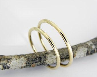 Wedding rings. 1.5mm diameter.14k yellow gold wedding rings set, in shiny finish.Hand forged wedding rings.