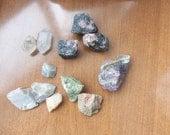 2 clear quartz, 3 rodonite, 4 moonstone, 1amethyst, 2 unakite. Rough gemstones.  (BAR99)