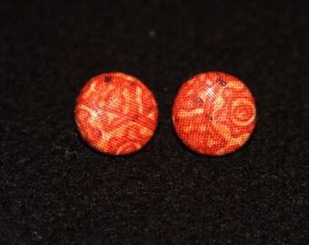 Orange batik fabric covered button earrings