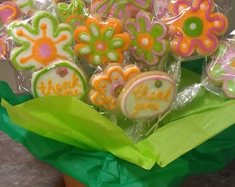 Say it with cookie flowers.  20 cookies on a stick make this wonderful bouquet.