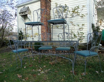 Vintage wrought iron Salterini magnolia pattern table and six chairs