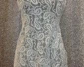 Textured Paisley Jacquard polyester/spandex jersey knit