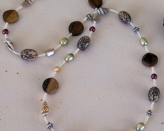 Naturals.. Betel nut, wood, freshwater pearl, shell and seed bead necklace, sterling silver