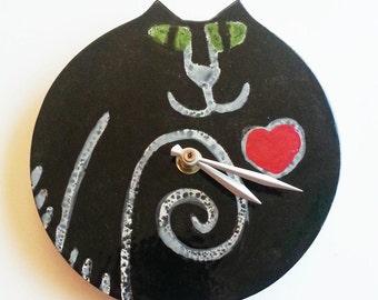 wall decor clock:  handmade by artist black cat green eyes ceramic whimsical kitty designer feline time