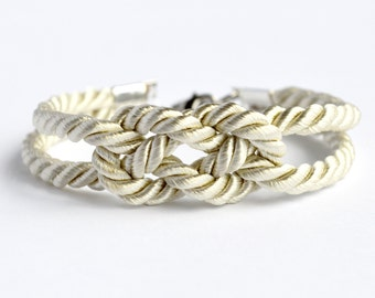 Shiny champagne double infinity knot nautical rope bracelet with silver anchor charm