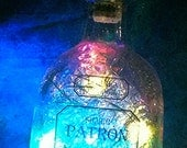 Feliz Navidad  Patron bottles lit up with Christmas and winter cheer
