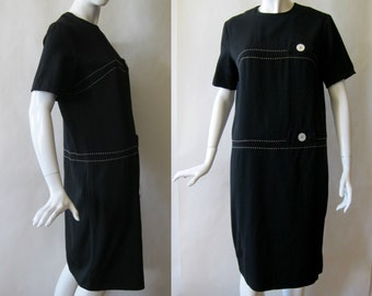 1960's Norman Wiatt fine wool dress, black with white topstitching, short sleeves, mod cut, and pearly buttons, large (12 - 14)