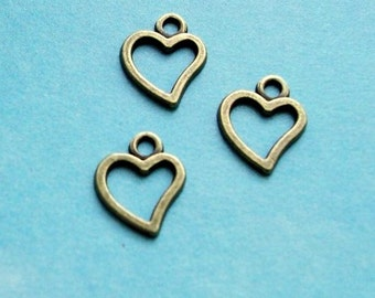 20 little asymmetrical heart outline charms, bronze tone, 10mm