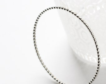 "One bangle, modern bracelet design of flattened beaded wire oxidized to show contrast - ""Reyna Bangle"""