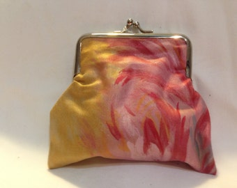 Coin purse silver metal clamp closure with pink and yellow floral cotton cover and canvas lining