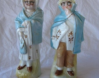 2 antique porcelain figurines - man and woman with wire glasses - very old
