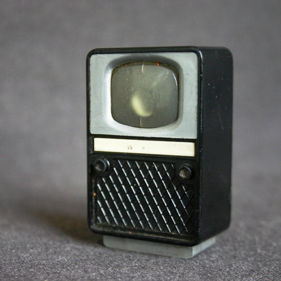 What is on telly tonight. Vintage Vienna souvenir black TV viewer.