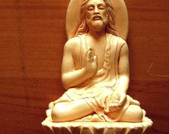 JESUS MEDITATING in an ivory finish  ( think about this concept )