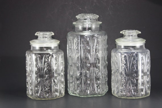 Shop Glass Canisters. Simple bathroom storage with a retro feel. Handmade glass canisters with nesting lids update a classic apothecary look/5().