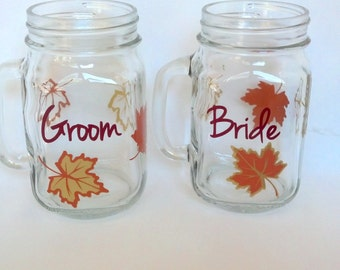 Autumn wedding, Bride and Groom, wedding party mason jars, gold brown and burnt orange leaves, fall theme.  Couples gift, Christmas gift.