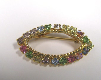 Vintage Multi Colored Rhinestone Oval Brooch In Gold tone Metal