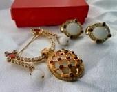 Vintage Striking Multiple Crystals, Glass Beads, Enamel,  Faux Garnet Insets, Hanging Brooch & Clip Earrings Set. Gold Tone In a Landau Box