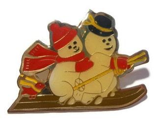 Snowmen brooch pin, holiday winter snowmen on skis pin brooch enamel on gold tone
