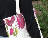 Bright pink beach bag in printed floral canvas with slide in pocket