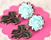 Brass bow earrings. post earrings. resin earrings. rose bow earrings. rose earrings. blue. pinup. pin up. rockabilly. tattoo. rock jewelry.