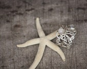 "sterling silver filigree ""lace"" ring with double tiny moonstones on it, light delicate and powerful"