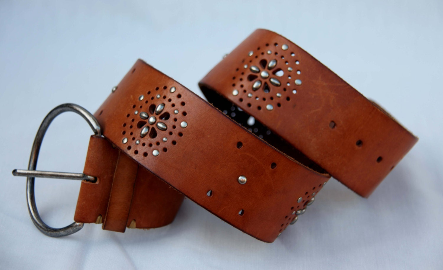 wide leather belt perforated floral pattern tooled rugged