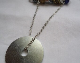 The Mechanic's Apprentice: pin with large zinc washer, silver chain