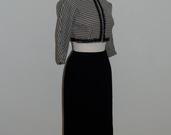 A lovely 1950s black fitted Vintage pencil skirt