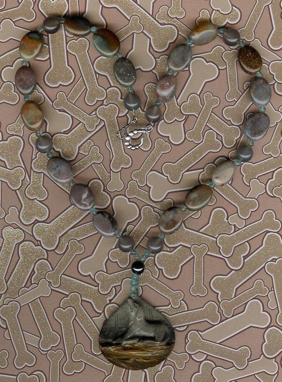 Bark relief carved succor creek jasper dog pendant