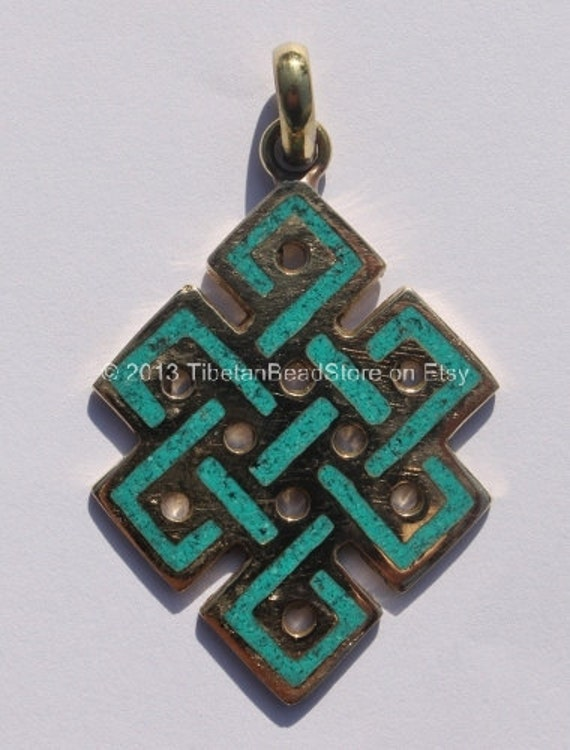 tibetan endless knot brass pendant with turquoise inlay