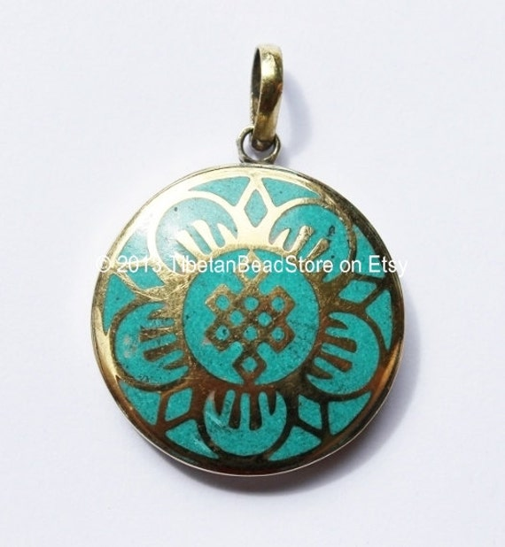 tibetan endless knot pendant with turquoise by
