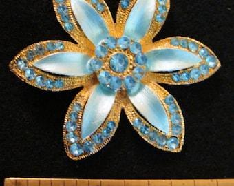 Blue enamel and rhinestone gold tone flower brooch