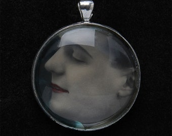 Pendant with old postcard under glass