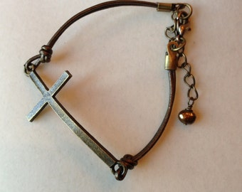 Sideways Bronze Cross Bracelet on Metallic Bronze Leather