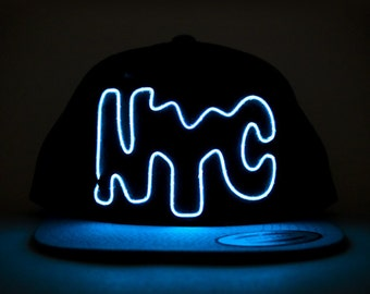 Light Up NYC Hat made with El Wire in all colors; blue, green, orange, yellow, pink, purple, white