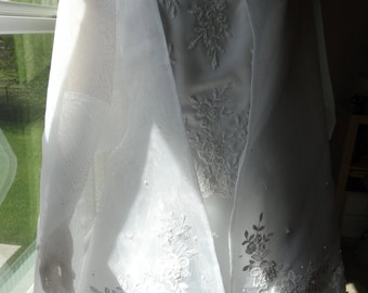 David's Bridal Wedding Gown, New with tags.