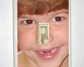 Custom photo-printed light switch cover. Light almond color.
